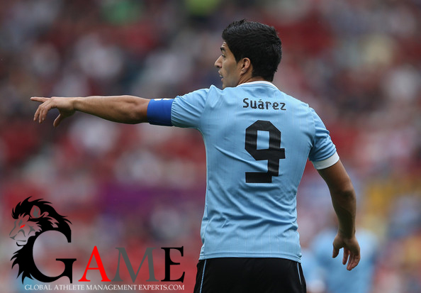 Luis Suarez tussle with Gonzalo Jara to be examined by Fifa